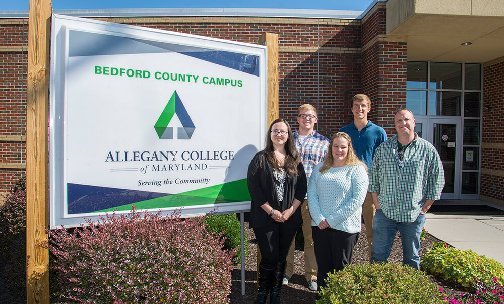 Bedford County Campus image of students standing in front of the main building