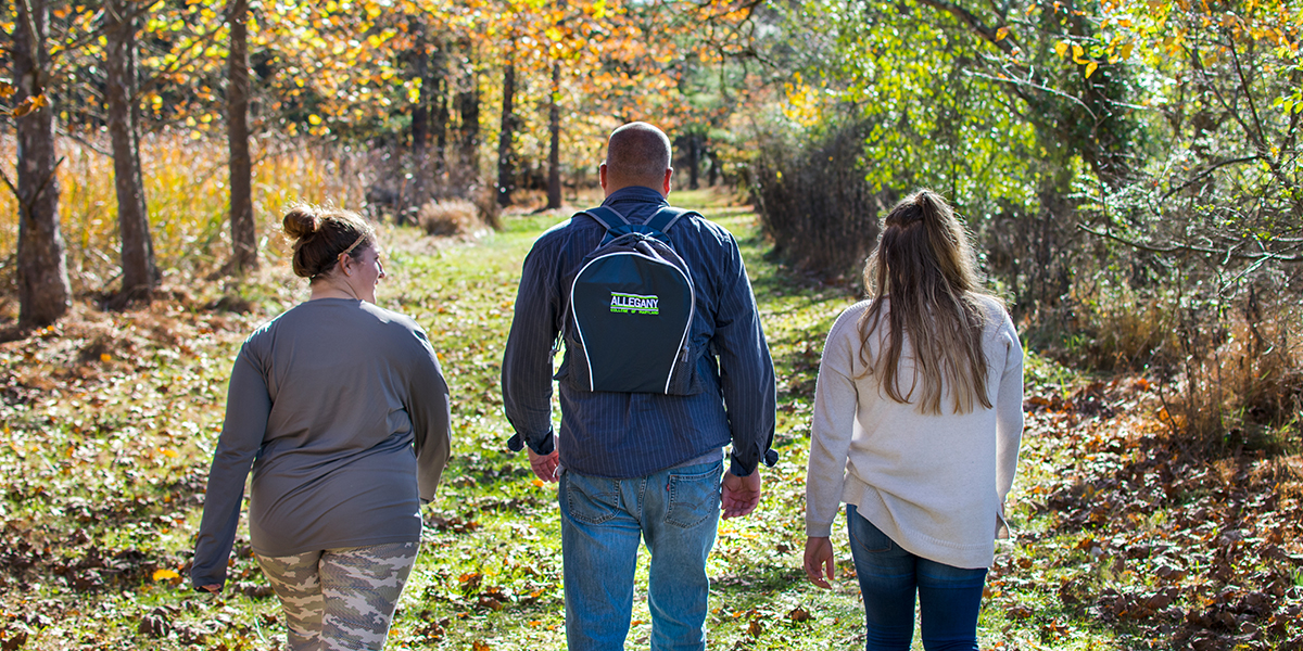 ACM Students walking around the woodland area of the campus