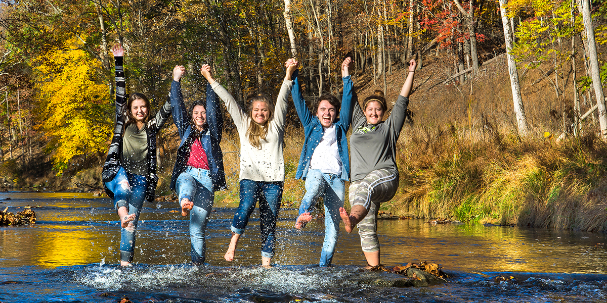 Students Jumping in the Creek