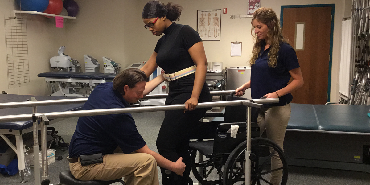 Physical Therapist assisting patient